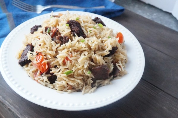 Nigerian coconut rice with fried meat