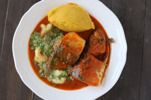 Nigerian mackerel Titus fish stew with yellow garri eba plain okro